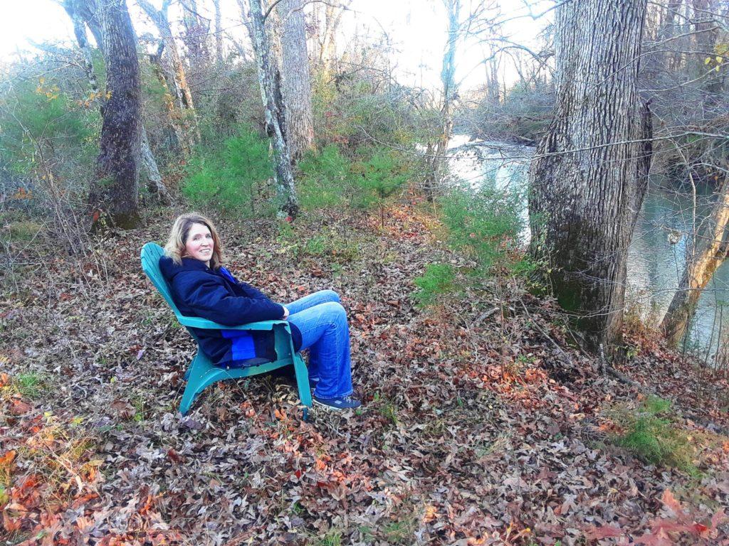 marnie sitting by creek